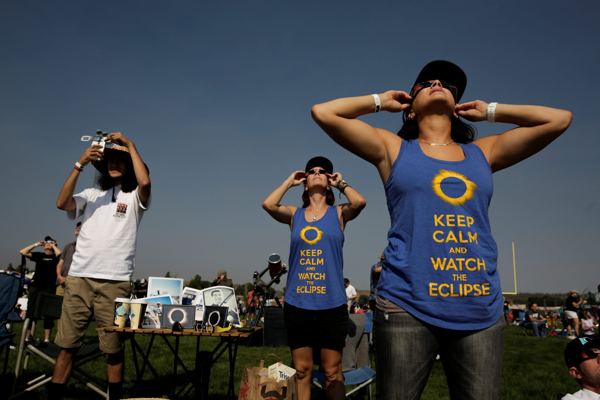 People watch the solar eclipse